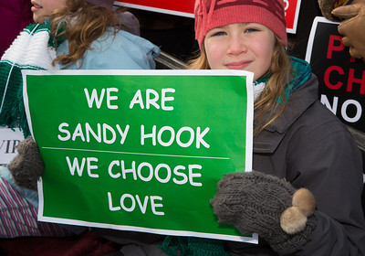 """We are Sandy Hoor. We Choose Love"". Wearing the green and white colors of Sandy Hook Elementary School where 26 children and adults were killed, 100 residents from Newtown, Connecticut joined thousands of other gun-control activists on Saturday, January 26, 2013 in Washington D.C. in a march down Constitution Ave. to a rally with speeches, musical performances and a poetry reading near the Washington Monument."