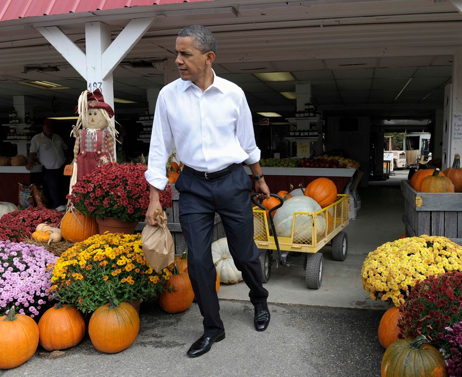 . President Barack Obama stops to buy pumpkins at Wood\'s Orchard in Hampton, Va, Wednesday, Oct. 19, 2011. Obama is on a three-day bus tour promoting the American Jobs Act. (AP Photo/Susan Walsh)
