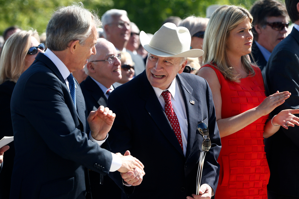 Description of . Former Vice President Dick Cheney, center, shakes hands with former British Prime Minister Tony Blair during the dedication of the George W. Bush presidential library on the campus of Southern Methodist University in Dallas, Thursday, April 25, 2013. Former President George W. Bush's daughter Jenna Bush Hager is at right. (AP Photo/Charles Dharapak)