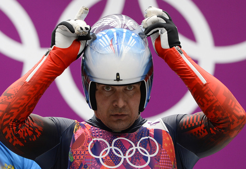 . Russia\'s Albert Demchenko competes during the Men\'s Luge Singles run two at the Sliding Center Sanki during the Sochi Winter Olympics on February 8, 2014.  (LIONEL BONAVENTURE/AFP/Getty Images)