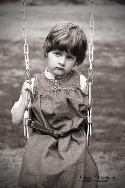 Lydia on swing sepia.jpg