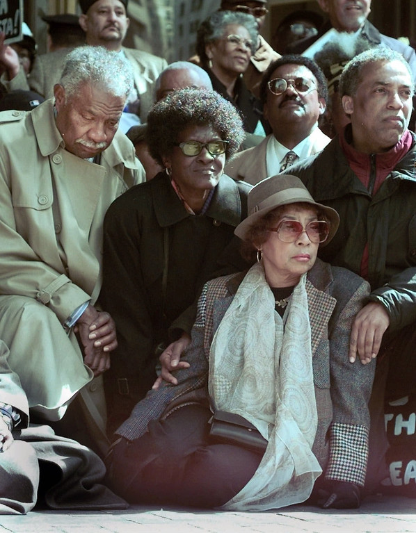 . Actors and activists Ruby Dee, second from right, and her husband Ossie Davis, left, wait to be arrested while protesting Tuesday March 23, 1999, at New York\'s police headquarters. More than 300 people had been arrested in protests which organizers said were held until the officers who killed Amadou Diallo, an unarmed West African immigrant, were arrested.  (AP Photo/Adam Nadel)