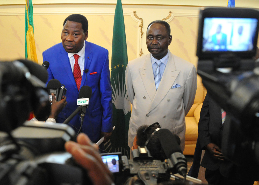 Description of . Current president of the African Union and President of Benin Yayi Boni (L) speaks during a joint press conference with the President of the Central African Republic Francois Bozize (2nd R) at the airport in Bangui, on December 30, 2012. Rebels in the Central African Republic who have advanced towards the capital Bangui warned they could enter the city even as the head of the African Union prepared to launch peace negotiations. Central African President Francois Bozize also stated today he was open to a national unity government after talks with rebel leaders and that he would not run for president in 2016. SIA KAMBOU/AFP/Getty Images