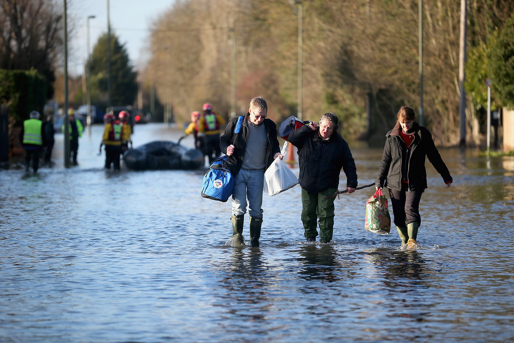 . Residents evacuate their flooded homes on February 11, 2014 in Chertsey, United Kingdom. The Environment Agency contiues to issue severe flood warnings for a number of areas on the river Thames in the commuter belt west of London. With heavier rains forecast for the coming week people are preparing for for the water levels to rise.  (Photo by Christopher Furlong/Getty Images)