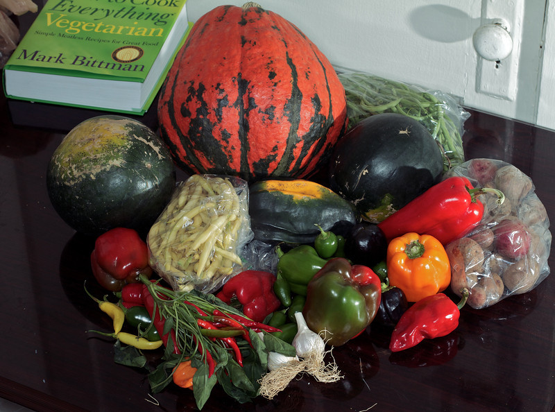 The farmshare haul for the week.  That big pumpkin-looking thing is a Lakota Squash - it's supposedly delicious (and about the size of a basketball).  Otherwise, two watermelon, an acorn squash, a bag of potatoes, two bags of beans, peppers galore (sweet, poblano, jalapeño, and more), and some garlic.  I also highly recommend the Bittman book.