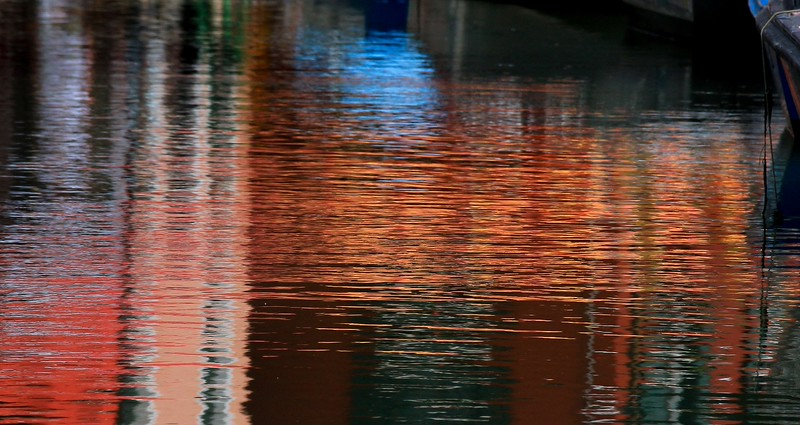 An orange awning reflection