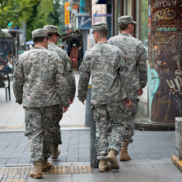 Army soldiers walking on sidewalk, Seoul, South Korea