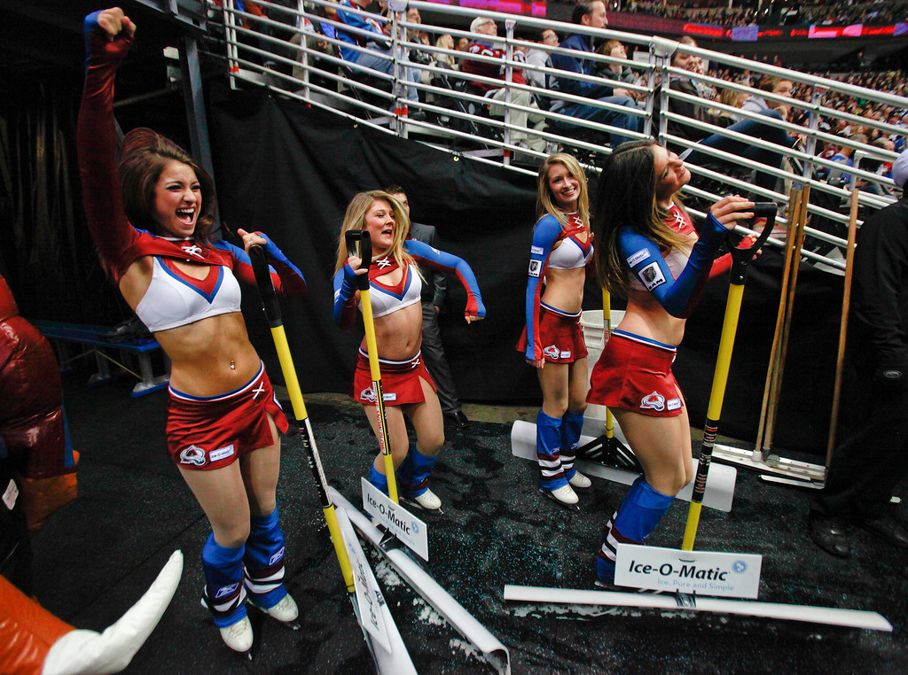 . The Colorado Avalanche Ice Girls dance during a break in the action during the second period of an NHL hockey game between the Avalanche and the Calgary Flames, Friday, Nov. 8, 2013, in Denver. The Avalanche won 4-2. (AP Photo/Barry Gutierrez)