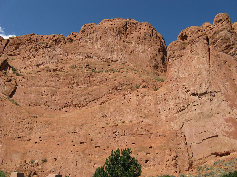 OK, Sunday morning at Garden of the Gods. Looking up at the wall that Julian and I will traverse - along the line of the green plants up high.