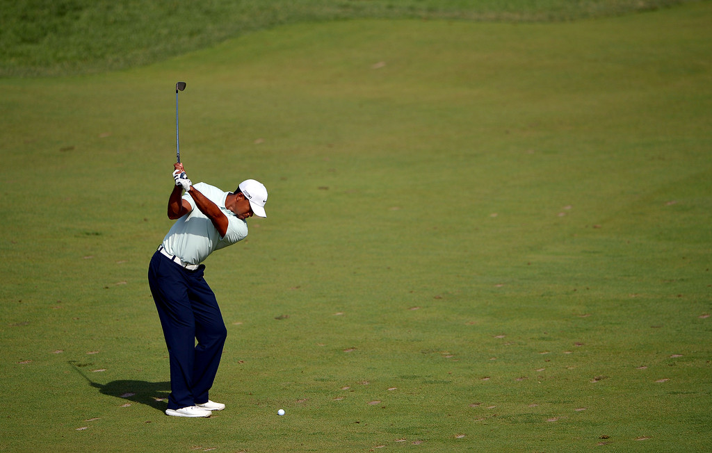 . Tiger Woods of the United States hits his second shot on the 11th hole during Round Three of the 113th U.S. Open at Merion Golf Club on June 15, 2013 in Ardmore, Pennsylvania.  (Photo by Drew Hallowell/Getty Images)