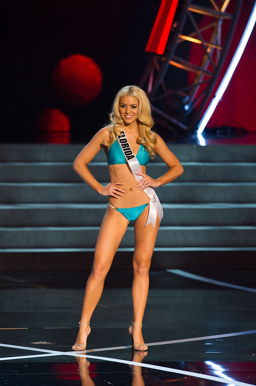 . In this photo provided by the Miss Universe Organization,  Miss Florida USA 2013, Michelle Aguirre,  competes in her swimsuit during the  2013 Miss USA Competition Preliminary Show in Las Vegas on Wednesday June 12, 2013.   She will compete for the title of Miss USA 2013 and the coveted Miss USA Diamond Nexus Crown on June 16, 2013.  (AP Photo/Miss Universe Organization, Darren Decker)
