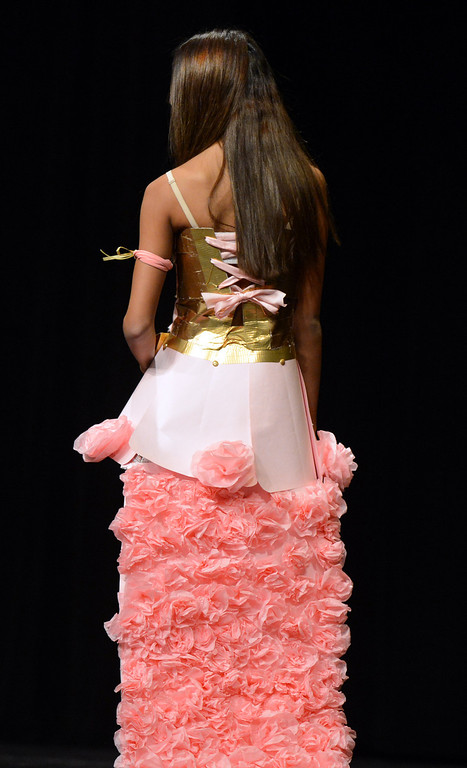 . Bathroom tissue flowers cascade down this skirt modeled by Chelsea Correa at the third annual Paper Skirt Fashion Show held at Liberty High School in Brentwood, Calif.  on Tuesday, Jan. 29, 2013.  Metalic gold duct tape makes up most of the bodice.  (Susan Tripp Pollard/Staff)