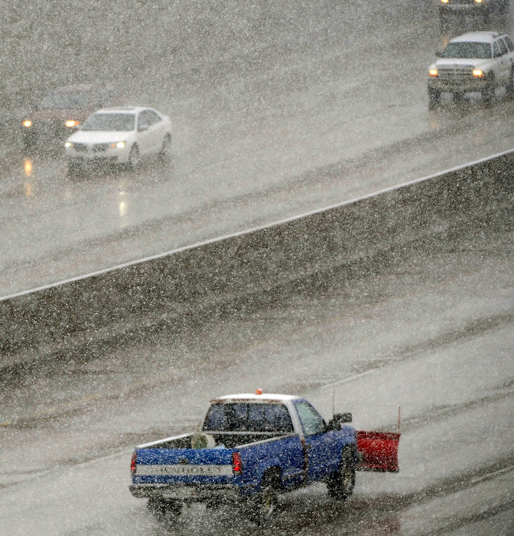 . DENVER, CO. - MARCH 9TH: Vehicles make their way through steady snowfall on I-25 near the University of Denver Saturday morning, March 9th, 2013(Photo By Andy Cross/The Denver Post)