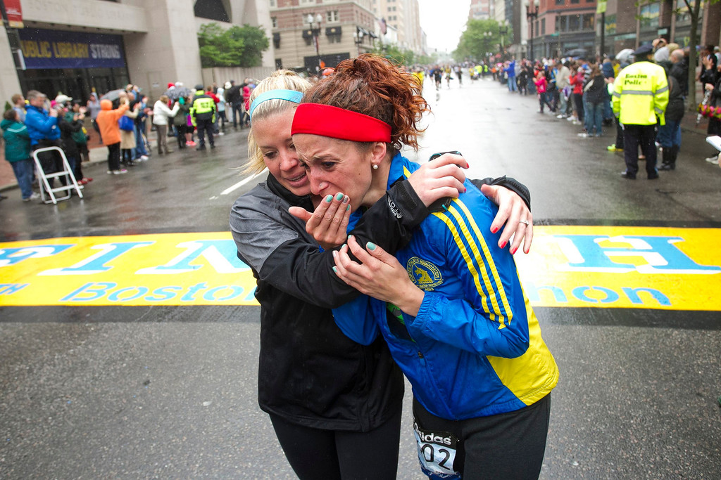 ". Erin Roy (L) comforts Elise Wulff as runners cross the finish line after completing the final mile of the Boston Marathon course during ""#onerun\"" in Boston, Massachusetts, May 25, 2013. Wulff participated in the marathon but was unable to finish when the course was shut down following the bombing attack.    REUTERS/Dominick Reuter"