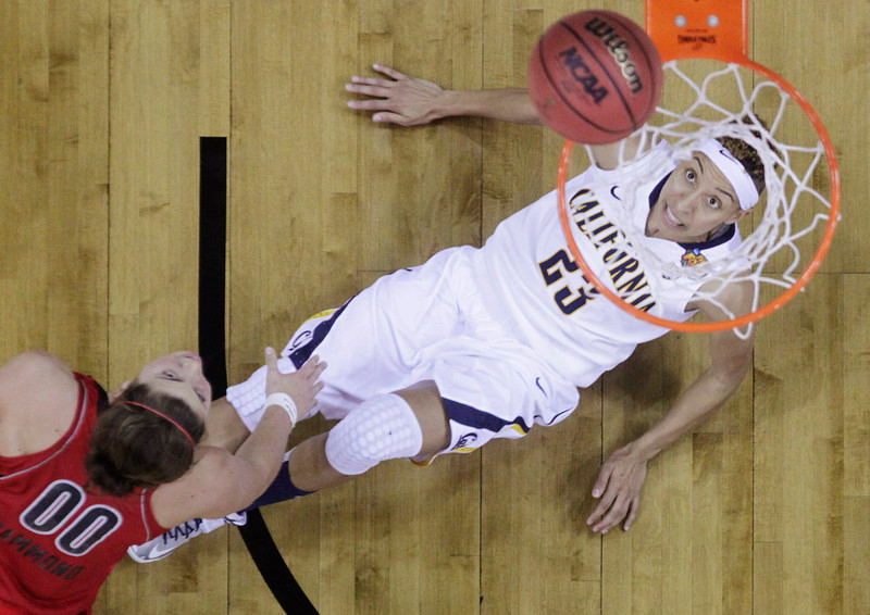 . California guard Layshia Clarendon (23) looks at the ball as Louisville forward Sara Hammond (00) shoots in the second half of a national semifinal at the Women\'s Final Four of the NCAA college basketball tournament, Sunday, April 7, 2013, in New Orleans. (AP Photo/Dave Martin)