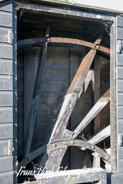 Waterwheel of the Wipmill De Kikkermolen Leiden Holland. The smallest windmill of the Netherlands
