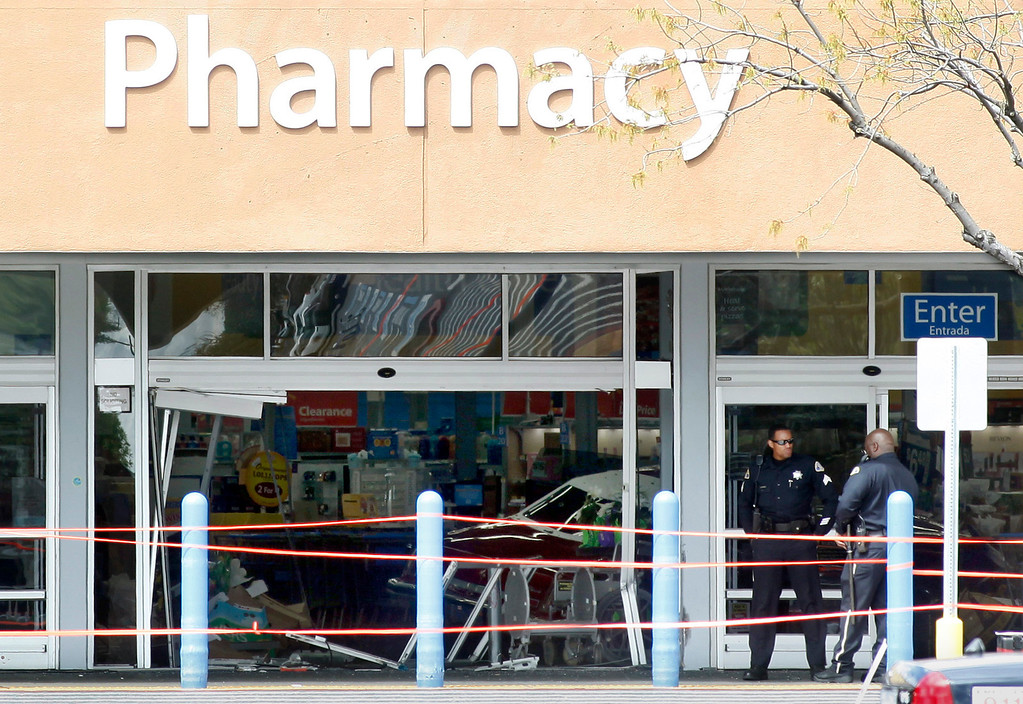 . Police investigate an incident at the Walmart on Story Road in San Jose, Calif., where a vehicle drove into the building and a driver reportedly began assaulting people in the store on Sunday afternoon March 31, 2013. (Karl Mondon/Staff)
