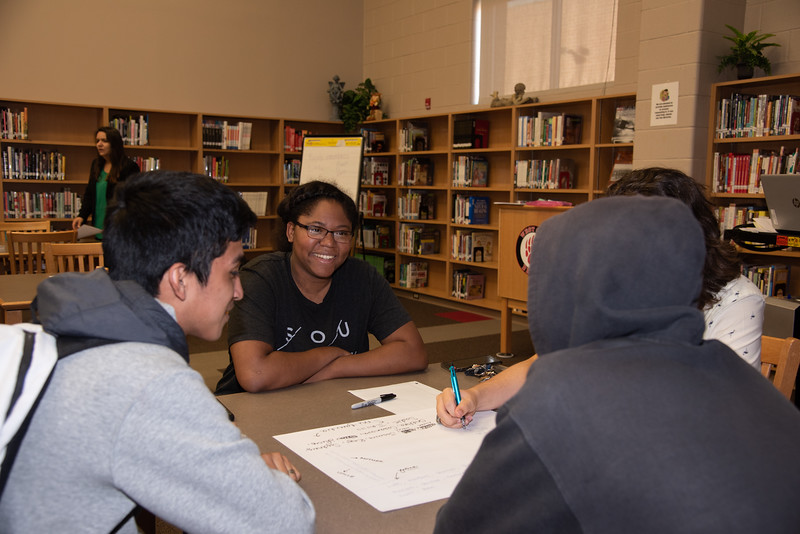 Kristen Jones (middle) with West Oso High School students at the Spanish event at the library.