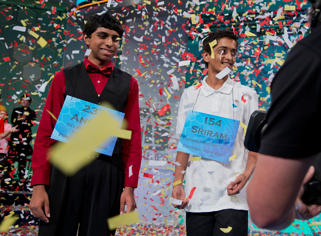 . The 2014 Scripps National Spelling Bee Co-Champions Ansun Sujoe, left, of Fort Worth, Texas, and Sriram Hathwar, of Painted Post, N.Y., celebrate after winning the Scripps National Spelling Bee competition, Thursday, May 29, 2014, at National Harbor in Oxon Hill, Md. (AP Photo/Manuel Balce Ceneta)