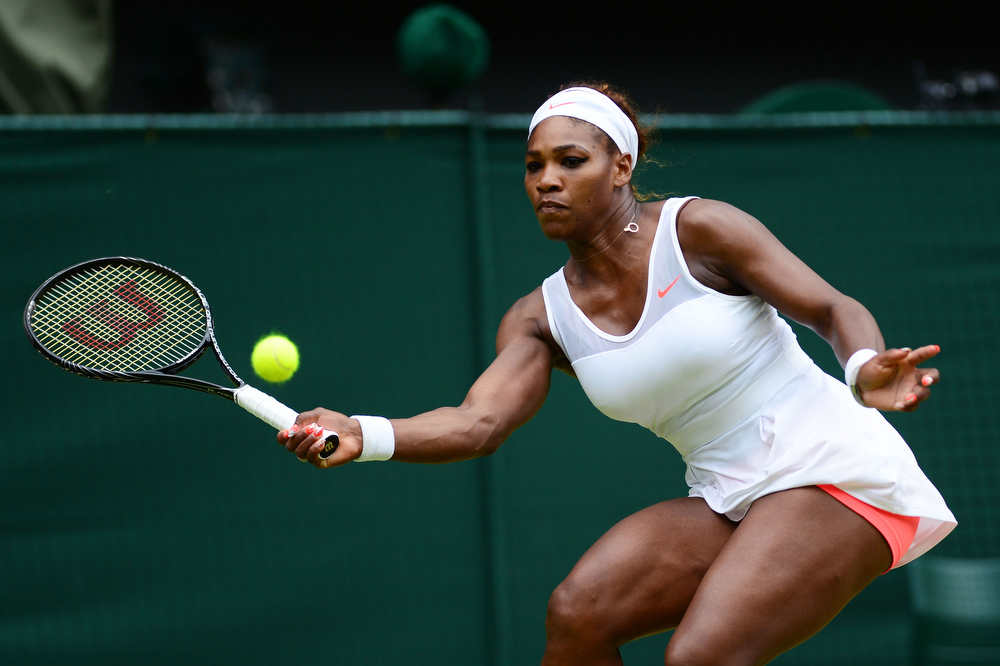 . Serena Williams of United States of America plays a forehand during her Ladies\' Singles fourth round match against Sabine Lisicki of Germany on day seven of the Wimbledon Lawn Tennis Championships at the All England Lawn Tennis and Croquet Club on July 1, 2013 in London, England.  (Photo by Mike Hewitt/Getty Images)