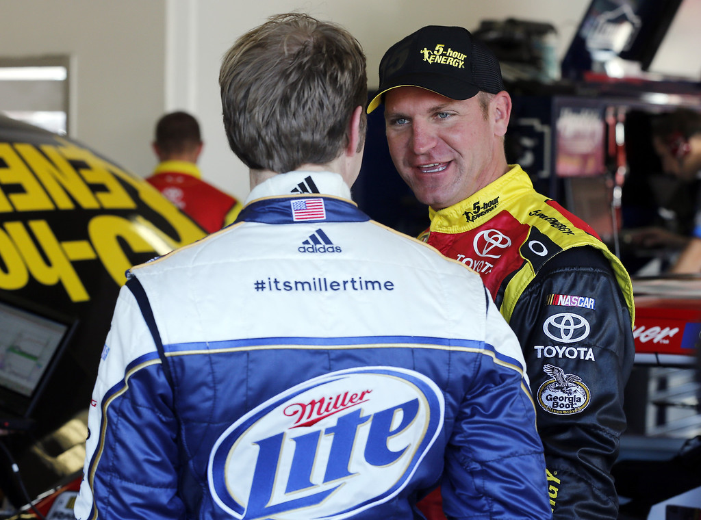 . DAYTONA BEACH, FL - FEBRUARY 20:  Clint Bowyer (R), driver of the #15 5-hour ENERGY Toyota, talks with Brad Keselowski (L), driver of the #2 Miller Lite Ford, during practice for the NASCAR Sprint Cup Series Daytona 500 at Daytona International Speedway on February 20, 2013 in Daytona Beach, Florida.  (Photo by Sam Greenwood/Getty Images)