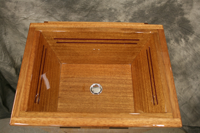 New solid mahogany vainty sink with purple heart inlay.