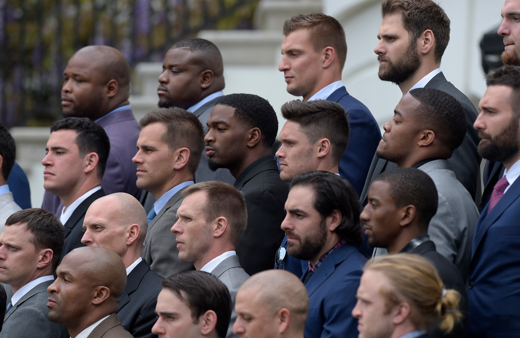 . Members of the New England Patriots, including tightend Robert Gronkowski, top center right, listen as President Donald Trump speaks during a ceremony on the South Lawn of the White House in Washington, Wednesday, April 19, 2017, where the president honored the Super Bowl Champion New England Patriots for their Super Bowl LI victory. (AP Photo/Susan Walsh)