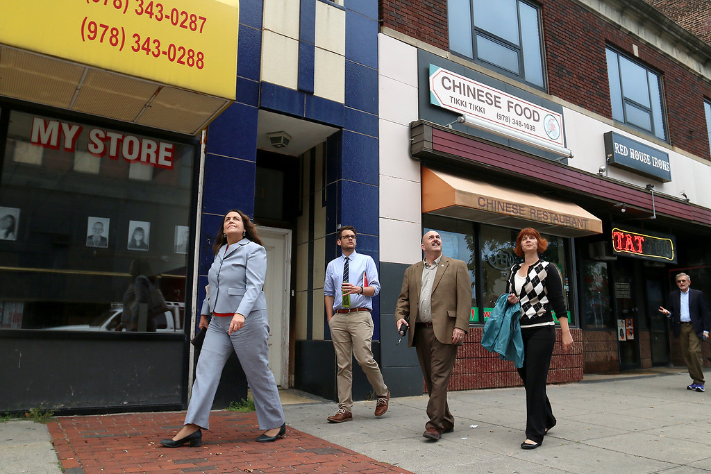 . From left is Fitchburg\'s Director of Economic Development Mary Jo Bohart, Fitchburg\'s Community Development Executive Director Tom Skwierawski, Vice President for Economic Development with Smart Growth America Christopher Zimmerman and Community Development Director of Housing and Development Liz Murphy as they take a tour of the downtown on Tuesday afternoon. SENTINEL & ENTERPRISE/JOHN LOVE