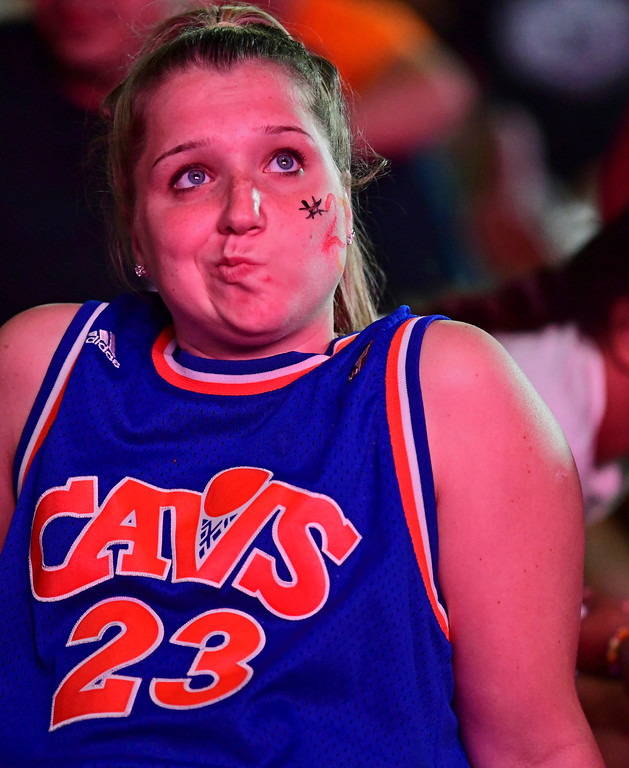 . A Cleveland Cavaliers fan reacts during a watch party outside Quicken Loans Arena for Game 4 of basketball\'s NBA Finals between the Cavaliers and the Golden State Warriors, Friday, June 8, 2018, in Cleveland. Golden State won 108-85 to sweep the series. (AP Photo/David Dermer)