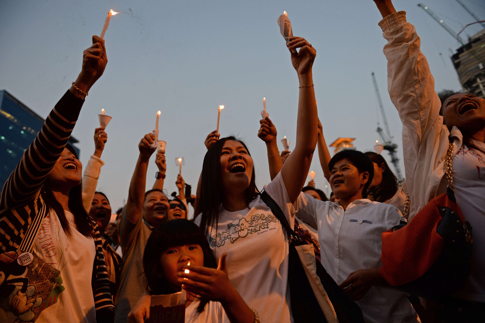 . Thai pro-election activists gather in a candle-light vigil at a park in Bangkok on January 16, 2014.  Thailand\'s government pleaded with police on January 16 to arrest opposition protest leaders who have threatened to take the prime minister captive and paralyzed parts of central Bangkok.  (CHRISTOPHE ARCHAMBAULT/AFP/Getty Images)