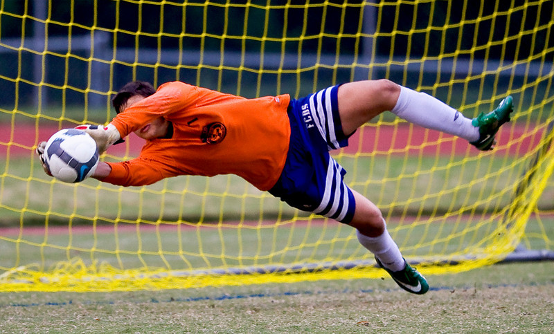 In a game against Charlotte Latin, the Forsyth Country Day goal keeper stretches to make a spectacular save!