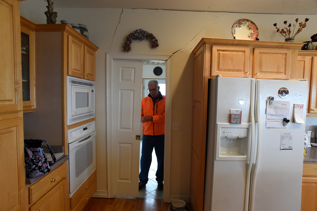 . Homeowner Denny Cripps is barely able to open this sliding wooden door in his home in Broadmoor Bluffs on April 11, 2016 in Colorado Springs, Colorado.  There are cracks that run all along the ceiling, down the wall and into the doorway. The Cripps are among 200 homeowners who have applied for federal bailouts because their home is being eaten up by collapsing expansive soil that is part of an ancient and massive landslide area.  Their home has cracked walls, uneven floors and is literally sliding down the mountain.  It is a problem that city officials have known about since the mid-1990\'s when city planners approved developments on what geologists have called some of the most unstable geology on the front range.  (Photo by Helen H. Richardson/The Denver Post)
