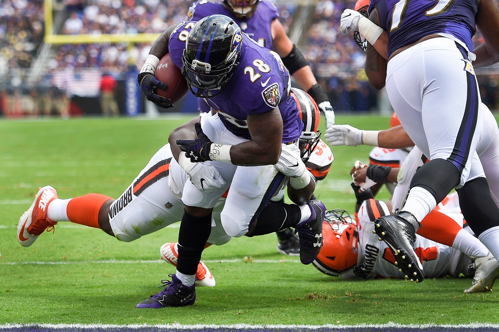 . Baltimore Ravens running back Terrance West (28) carries the ball into the end zone for a touchdown during the first half of an NFL football game against the Cleveland Browns in Baltimore, Sunday, Sept. 17, 2017. (AP Photo/Nick Wass)