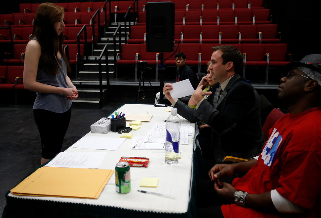 . Sarah Kuhs, left, talks with Clayton Lawrence, second from right - in suit, during her audition during a casting call for Great America theme park for their various characters and dancers in Hall Todd Theatre at San Jose State University on Wednesday, Feb. 6, 2013.  (Nhat V. Meyer/Staff)