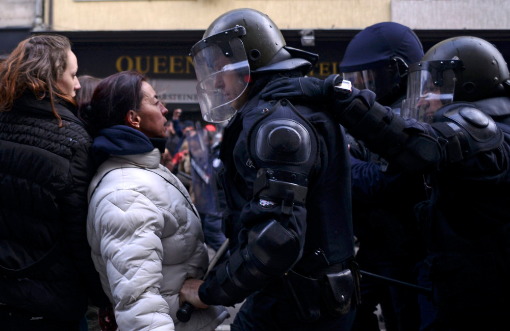 . A woman argues with a riot policeman during a protest against high electricity bills in Sofia February 17, 2013. Tens of thousands of Bulgarians protested in more than 20 cities against high electricity bills on Sunday, piling pressure on the government after a week of persistent demonstrations.  REUTERS/Tsvetelina Belutova
