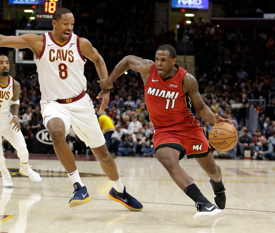 . Miami Heat\'s Dion Waiters (11) drives against Cleveland Cavaliers\' Channing Frye (8) in the second half of an NBA basketball game, Tuesday, Nov. 28, 2017, in Cleveland. The Cavaliers won 108-97. (AP Photo/Tony Dejak)