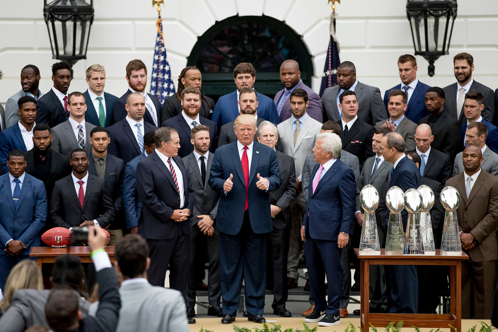 . President Donald Trump stands with New England Patriots head coach Bill Belichick, left, New England Patriots owner Robert Kraft, right, and members of the New England Patriots during a ceremony on the South Lawn of the White House in Washington, Wednesday, April 19, 2017, where he honored the Super Bowl Champion New England Patriots for their Super Bowl LI victory. (AP Photo/Andrew Harnik)