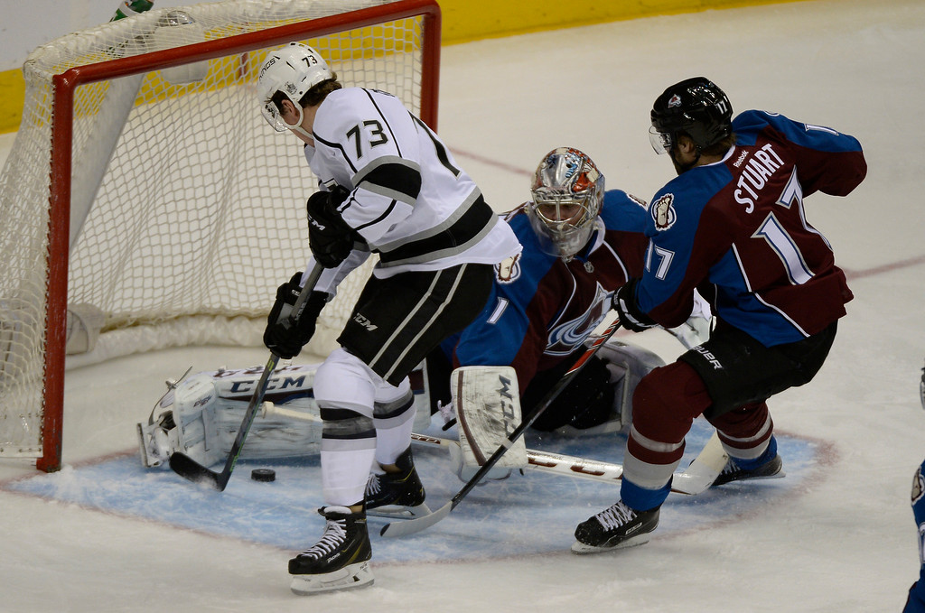 . DENVER, CO - FEBRUARY 18: Los Angeles Kings center Tyler Toffoli (73) finds the puck and pushes it past the leg pad of Colorado Avalanche goalie Semyon Varlamov (1) for the goal in the second period  February 18, 2015 at Pepsi Center. (Photo By John Leyba/The Denver Post)