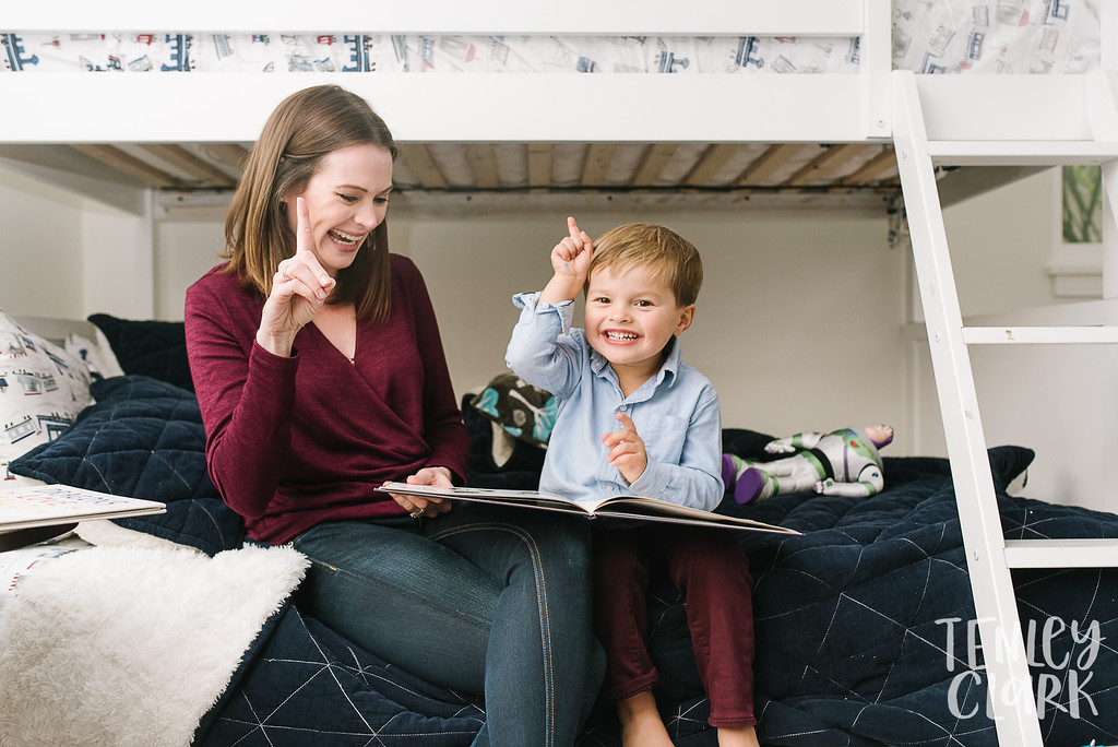 Mom and son reading together in his room.Lifestyle in-home family photoshoot in Marin, CA by Tenley Clark Photography.
