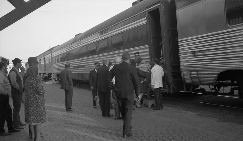 2018.15.N79.6214A--ed wilkommen 116 neg--N&W--passenger train at station loading scene just prior to Amtrak--location unknown--no date