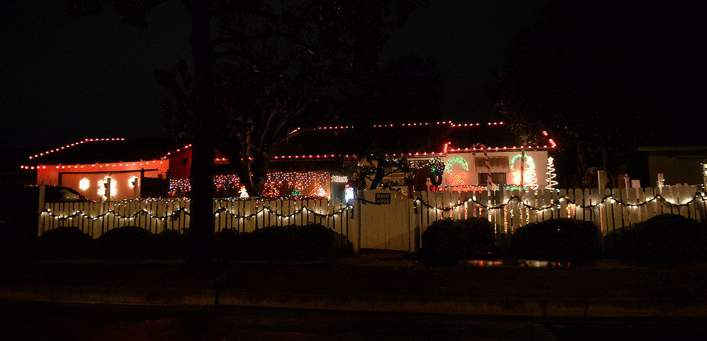 . A home is decorated with holiday lights along Cypress St and Larkin Dr in Covina, Calif., on Thursday, Dec. 19, 2013.     (Keith Birmingham Pasadena Star-News)