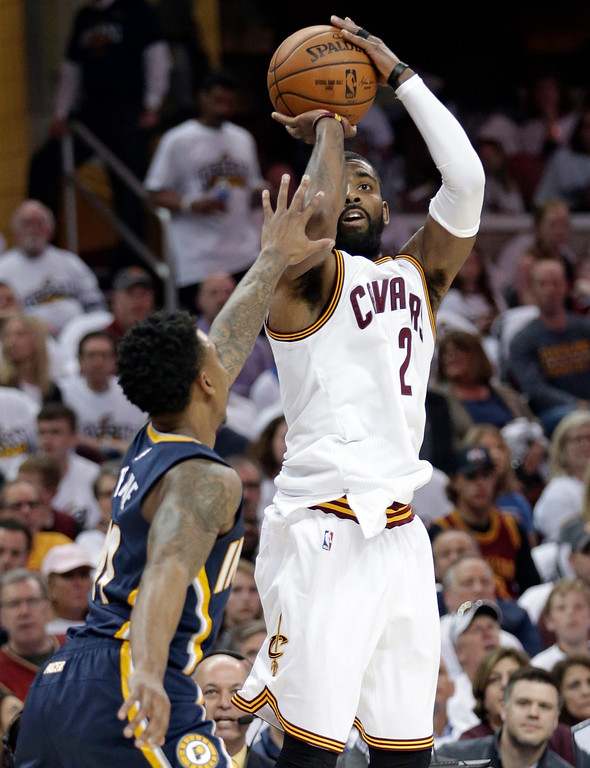 . Cleveland Cavaliers\' Kyrie Irving (2) shoots over Indiana Pacers\' Jeff Teague (44) in the first half in Game 1 of a first-round NBA basketball playoff series, Saturday, April 15, 2017, in Cleveland. (AP Photo/Tony Dejak)