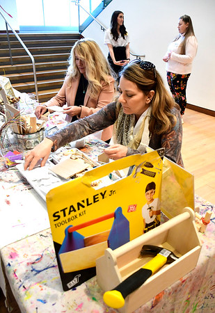 3/5/2020 Mike Orazzi | Staff Eva Dambrowski and Lori Zajac work on wood crafts during the Stanley Black & Decker International Women's Day Celebration in New Britain on Thursday afternoon.