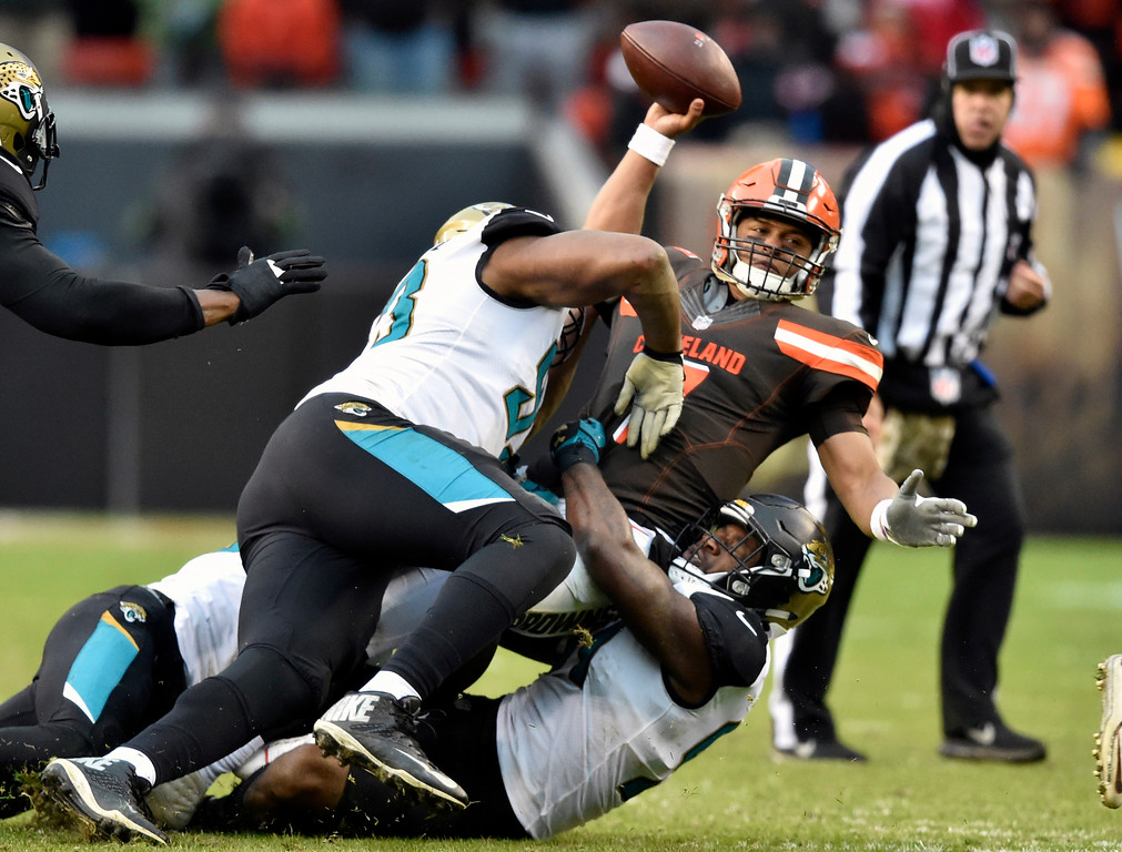. Cleveland Browns quarterback DeShone Kizer (7) is sacked in the second half of an NFL football game against the Jacksonville Jaguars, Sunday, Nov. 19, 2017, in Cleveland. (AP Photo/David Richard)
