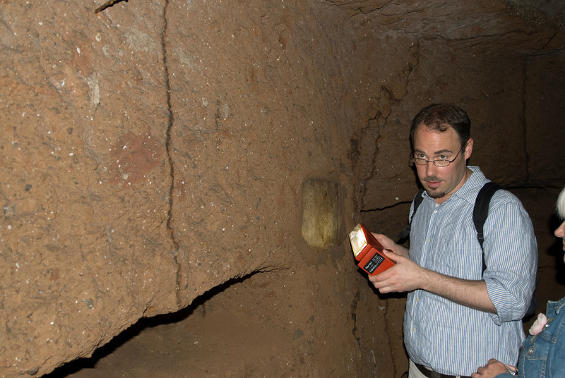 Tour guide inside the archaeological site in Rome, Italy