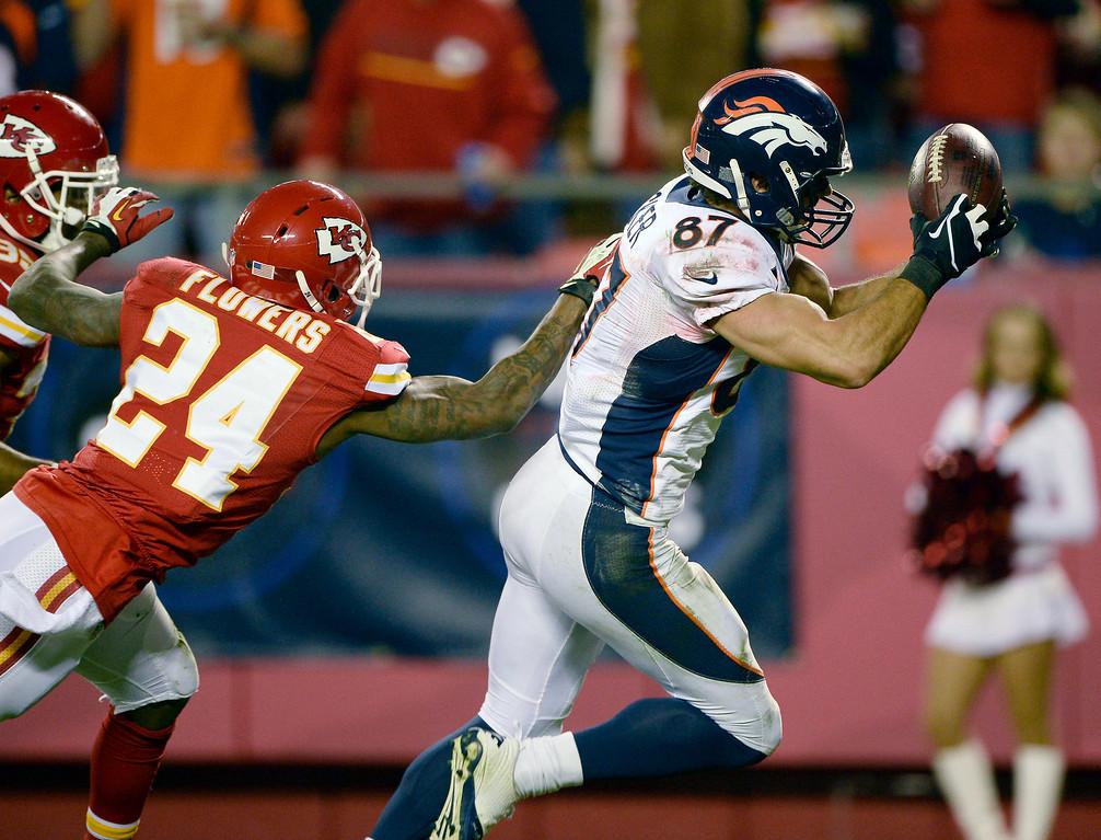 . Denver Broncos wide receiver Eric Decker (87) reaches out for a pass for a touchdown on Kansas City Chiefs cornerback Brandon Flowers (24) during the third quarter December 1, 2013 at Arrowhead Stadium.  (Photo by John Leyba/The Denver Post)