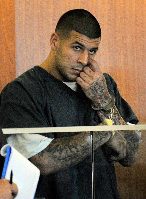 . Former New England Patriots football player Aaron Hernandez stands during a bail hearing in Fall River Superior Court Thursday, June 27, 2013 in Fall River, Mass. Hernandez, charged with murdering Odin Lloyd, a 27-year-old semi-pro football player, was denied bail. (AP Photo/Boston Herald, Ted Fitzgerald, Pool)