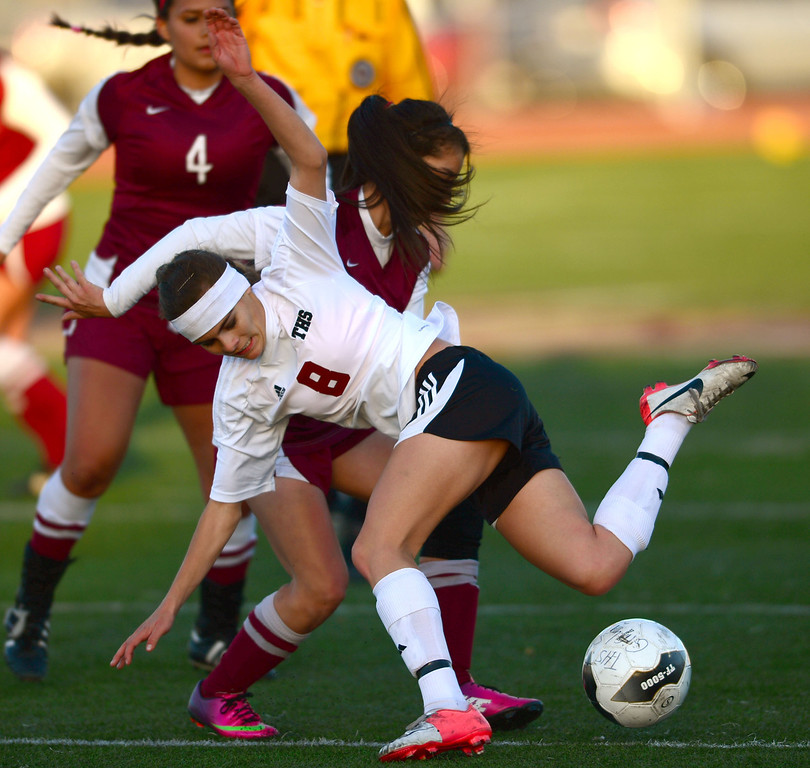 . Downey\'s Jocelyn Maldonado (18) battles Torrance\'s Kaitlyn Johnson(8) in a CIF SS Division IV quarterfinal game Thursday at Zamperini Field. Downey won the game 3-1. 20130221 Photo by Steve McCrank / Staff Photographer