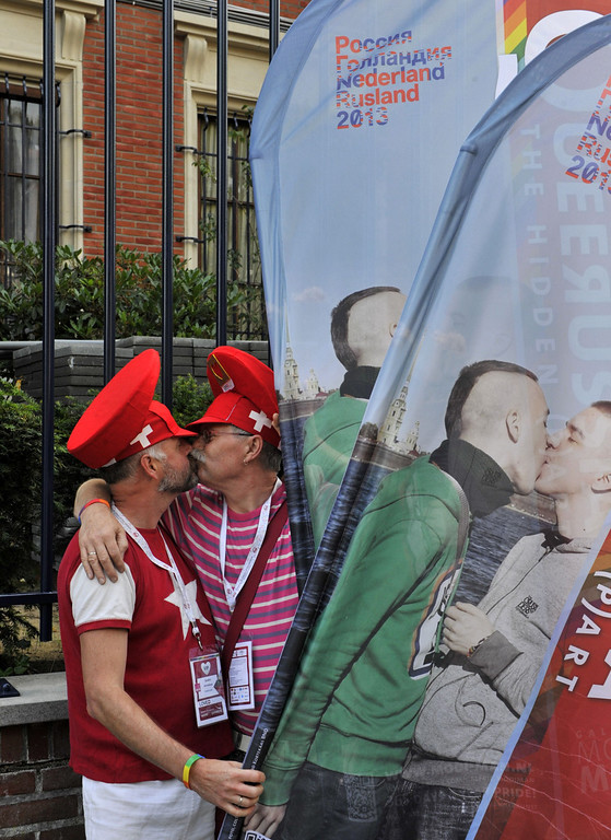 ". An homosexual couple kisses during  \'Kiss-In\' action by more than 300 gay and lesbian supporters participate in front of the Russian consulate in Antwerp to protest against the treatment of lesbian, gay, bisexual and transgender oriented people in Russia on August 9, 2013.  Russia on Friday said it was unperturbed by threats of an Olympic boycott over a controversial law banning ""homosexual propaganda\"", despite wide-ranging criticism of the legislation from athletes to US President Barack Obama. GEORGES GOBET/AFP/Getty Images"