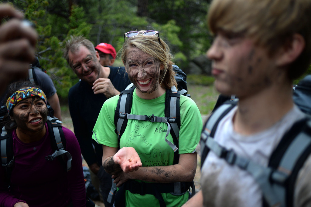 . WARD, CO - JUNE 10: Joanna Rivera (left), Mark Bond and Elizabeth Beem react as Taylor Beem is the first student to eat a grub the class found beneath a log. Bear Grylls survival school at Glacier View Ranch near Ward, Colorado on Tuesday, June 10, 2014. (Photo by AAron Ontiveroz/The Denver Post)